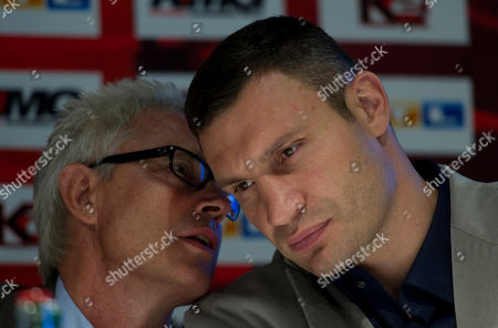 Vitali Klitschko, Bernd Boente Boxer and WBC heavyweight world champion Vitali Klitschko, right, of the Ukraine listens to his manager Bernd Boente, left, during a news conference in Hamburg, northern Germany, . Klitschko will fight Shannon Briggs for a title fight in the O2 World Arena in Hamburg, Germany, on Saturday, Oct. 16, 2010