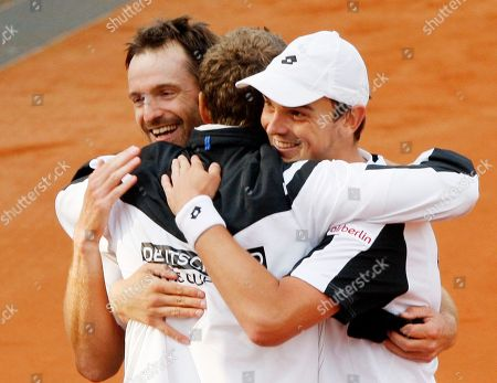 Andreas Beck, Christopher Kaas German doubles Andreas Beck, right, and Christopher Kas, left, embrace team captain Patrick Kuehnen after beating South African doubles Rik de Voest and Wesley Moodie during a tennis Davis Cup relegation match of the World Group between Germany and South Africa in Stuttgart, southern Germany, . Germany leads 3-0