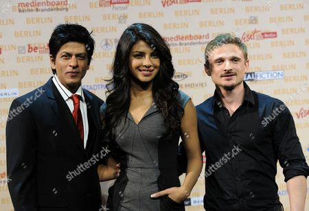 """Shah Rukh Khan, Priyanka Chopra, Florian Lukas Bollywood actor Shah Rukh Khan and co-star actress Priyanka Chopra, center and German actor Florian Lukas, right, pose during a photo call in Berlin, Germany, on . Shah Rukh Khan is working on his new action movie """"Don-2"""" in Berlin, where some of the scenes are shot"""