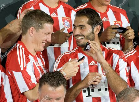 Hamit Altintop,Sebastian Schweinsteiger Sebastian Schweinsteiger, left, and Hamit Altintop of the German soccer team of Bayern Munich smile during a photo call in Munich, southern Germany, on Monday, Aug.2, 2010