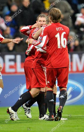 Sebastian Schweinsteiger Munich's Sebastian Schweinsteiger, center, celebrates with his teammates after scoring during the Group E Champions League Soccer match between Bayern Munich and CFR Cluj in Munich, southern Germany