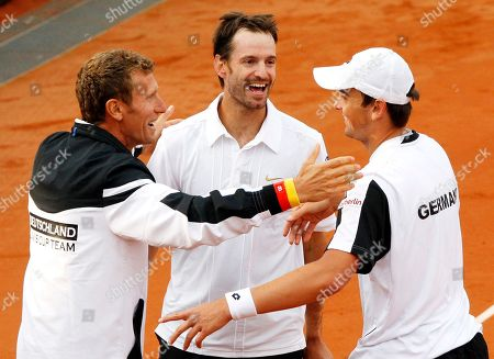 Andreas Beck, Christopher Kas, Patrick Kuehnen German doubles Andreas Beck, right, and Christopher Kas, center, celebrate with team captain Patrick Kuehnen after beating South African doubles Rik de Voest and Wesley Moodie during a tennis Davis Cup relegation match of the World Group between Germany and South Africa in Stuttgart, southern Germany