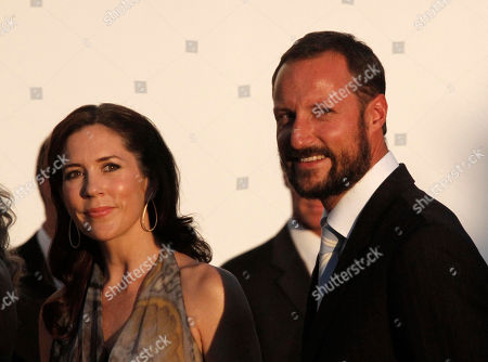 Princess Victoria of Denmark and Prince Haakon of Norway arrive at Agios Nikolaos church to attend the wedding ceremony of Prince Nikolaos, son of deposed King Constantine, and Tatiana Blatnik on the Greek island of Spetses