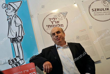 """Natan Sharansky Former Soviet political prisoner, Israeli politician and chairman of the Jewish Agency for Israel (Sochnut) Natan Sharansky is seen beside """"Srulik"""", an illustrated character who symbolizes Israel after announcing the opening of the new Israeli Cultural Institute, housed in Budapest, Hungary, . The World's first Israeli Cultural Institute will open its gate for the public on Friday. During the Holocaust some 550,000 Jews were killed, while some 100,000 Jews live in the country today, mostly in Budapest"""