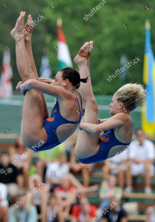 Britain's bronze medal winner Monique Gladding and Megan Sylvester make an attempt during the Women's 10m synchronized platform diving final at the Swimming European Championships in Budapest, Hungary