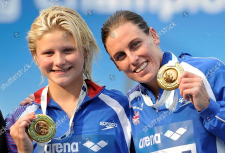 Britain's Monique Gladding, right, and Megan Sylvester show off their bronze medal after the Women's 10m synchronized platform diving final at the Swimming European Championships in Budapest, Hungary