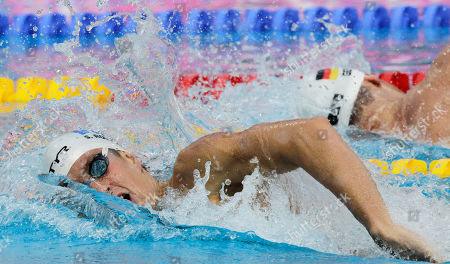 France's gold medal winner Sebastien Rouault swims in the Men's 800m freestyle final at the European Swimming Championships in Budapest, Hungary, . In background is Germany's Christian Kubusch, silver