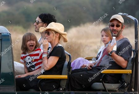 Russell Brand British actor-comedian Russell Brand, background left, sits next to Cornish writer and actress Morwenna Banks, her son Ezra Beckett between them and her husband, English comedian, novelist and television presenter David Baddiel at right next to their daughter Dolly Loveday, on a jeep during a jungle safari at the Ranthambore National Park in Ranthambore, India, . Russell Brand's friend and a bodyguard assaulted four news photographers, including one from The Associated Press, when they were taking pictures of the British comedian Friday in an Indian tiger reserve before his wedding to Katy Perry, the photographers said. The photographers had been following about 330 feet (100 meters) behind two jeeps, one carrying Brand, and the second carrying the bodyguard and another man later described by police as Brand's friend and wedding guest