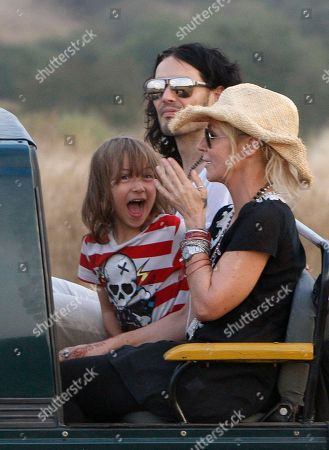 Stock Photo of British actor-comedian Russell Brand, back, sits next to Cornish writer and actress Morwenna Banks and her son Ezra Beckett on a jeep during a jungle safari at the Ranthambore National Park in Ranthambore, India, . Russell Brand's friend and a bodyguard assaulted four news photographers, including one from The Associated Press, when they were taking pictures of the British comedian Friday in an Indian tiger reserve before his wedding to Katy Perry, the photographers said. The photographers had been following about 330 feet (100 meters) behind two jeeps, one carrying Brand, and the second carrying the bodyguard and another man later described by police as Brand's friend and wedding guest