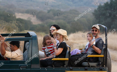 Russell Brand British actor-comedian Russell Brand, center back, sits next to Cornish writer and actress Morwenna Banks, her son Ezra Beckett between them and her husband, English comedian, novelist and television presenter David Baddiel at right next to their daughter Dolly Loveday, on a jeep during a jungle safari at the Ranthambore National Park in Ranthambore, India, . Russell Brand's friend and a bodyguard assaulted four news photographers, including one from The Associated Press, when they were taking pictures of the British comedian Friday in an Indian tiger reserve before his wedding to Katy Perry, the photographers said. The photographers had been following about 330 feet (100 meters) behind two jeeps, one carrying Brand, and the second carrying the bodyguard and another man later described by police as Brand's friend and wedding guest