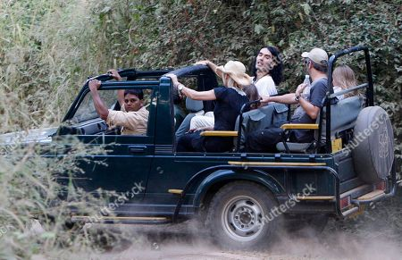 Russell Brand British actor-comedian Russell Brand, center, sits next to Cornish writer and actress Morwenna Banks, her son Ezra Beckett between them and her husband, English comedian, novelist and television presenter David Baddiel at right next to their daughter Dolly Loveday on a jeep during a jungle safari at the Ranthambore National Park in Ranthambore, India, . Russell Brand's friend and a bodyguard assaulted four news photographers, including one from The Associated Press, when they were taking pictures of the British comedian Friday in an Indian tiger reserve before his wedding to Katy Perry, the photographers said. The photographers had been following about 330 feet (100 meters) behind two jeeps, one carrying Brand, and the second carrying the bodyguard and another man later described by police as Brand's friend and wedding guest