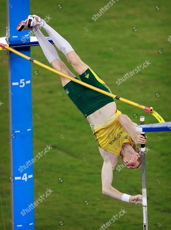 Australia's Steve Hooker clears a jump on his way to winning the gold medal in the pole vault final during the Commonwealth Games at the Jawaharhal Nehru Stadium in New Delhi, India