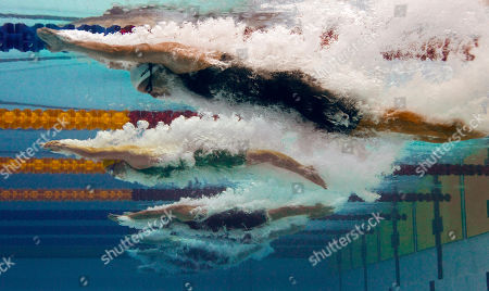 Joanne Jackson, Kylie Palmer, Alexandra Komarnycky From top, England's Joanne Jackson, Australia's Kylie Palmer, and Canada's Alexandra Komarnycky compete in the women's 400 m freestyle final during the Commonwealth Games at the Dr. S.P. Mukherjee Aquatics Center in New Delhi, India