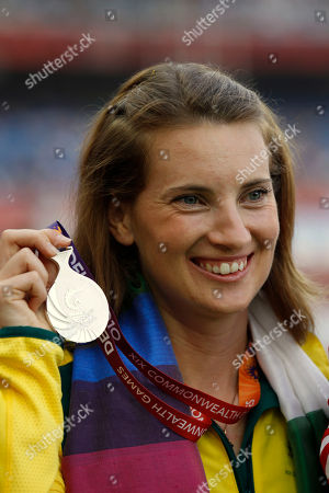 Australia's Claire Tallent poses with her silver medal for the Women's 20km Walk during the Commonwealth Games at the Jawaharlal Nehru Stadium in New Delhi, India