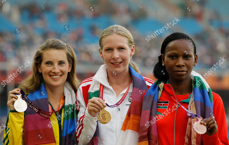 From left, Australia's Claire Tallent, England's Jo Jackson, Kenya's Grace Njue pose with their medals for the Women's 20km Walk during the Commonwealth Games at the Jawaharlal Nehru Stadium in New Delhi, India, . Jackson won gold, Tallent silver and Njue bronze