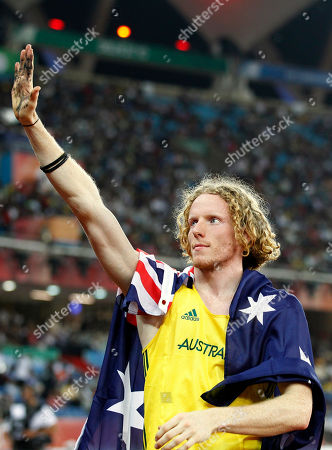 Australia's Steve Hooker gestures after winning gold in the Men's Pole Vault final during the Commonwealth Games at the Jawaharlal Nehru Stadium in New Delhi, India