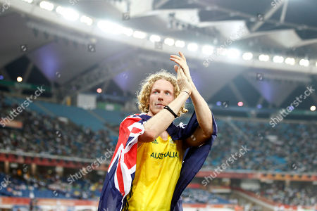 Australia's Steve Hooker applauds after winning gold in the Men's Pole Vault final during the Commonwealth Games at the Jawaharlal Nehru Stadium in New Delhi, India