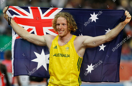 Australia's Steve Hooker celebrates winning gold in the Men's Pole Vault final during the Commonwealth Games at the Jawaharlal Nehru Stadium in New Delhi, India