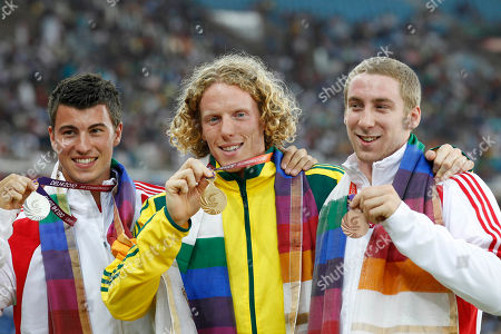 From left, England's Steven Lewis, Australia's Steve Hooker and England's Max Eaves pose with their medals for the Men's Pole Vault during the Commonwealth Games at the Jawaharlal Nehru Stadium in New Delhi, India, . Hooker won gold, Lewis silver and Eaves bronze