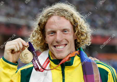 Australia's Steve Hooker poses with his gold medal for the Men's Pole Vault during the Commonwealth Games at the Jawaharlal Nehru Stadium in New Delhi, India