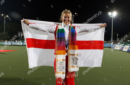 Natalie Melmore England's Natalie Melmore smiles at an award ceremony after winning the gold medal in the women's lawn bowls singles final during the Commonwealth Games at Jawaharlal Nehru Sports Complex New Delhi, India