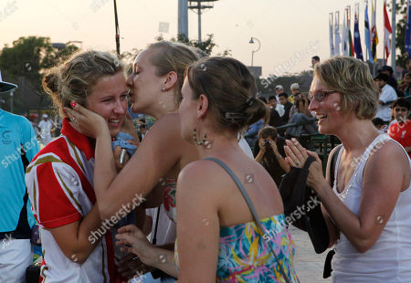 Natalie Melmore England's Natalie Melmore, left, is congratulated by fans after winning the gold medal in the women's lawn bowls singles final during the Commonwealth Games at Jawaharlal Nehru Sports Complex New Delhi, India
