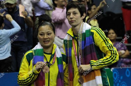 He Tian Tang, Smith Kate Wilson Australia's He Tian Tang, left, and Smith Kate Wilson hold the bronze medals they won in the women's badminton doubles final event during the Commonwealth Games at Siri Fort Sports Complex in New Delhi, India