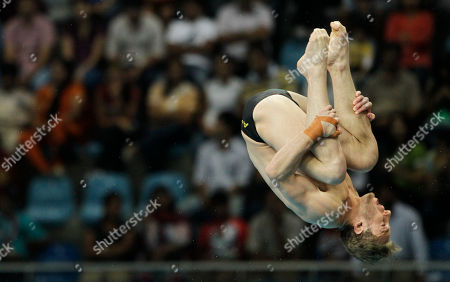 Matthew Mitcham Australia's Matthew Mitcham dives during the Men's 10m Platform diving final at the Dr. S.P. Mukherjee aquatics center during the Commonwealth Games in New Delhi, India, . Mitcham won silver
