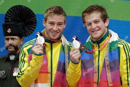 Matthew Mitcham, Ethan Warren Australia's Ethan Warren, left, and Matthew Mitcham show their silver medals for the men's 10m synchro platform diving event during the Commonwealth Games at the Dr. S.P. Mukherjee Aquatics Center in New Delhi, India