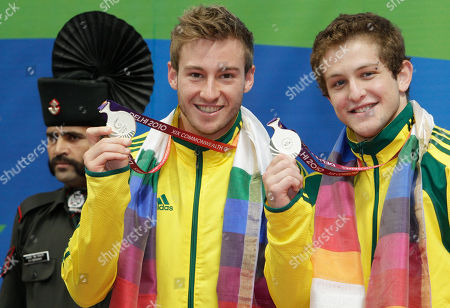 Ethan Warren, Matthew Mitcham Australia's Matthew Mitcham, left, and Ethan Warren show their silver medals in the men's 3m springboard diving event during the Commonwealth Games at the Dr. S.P. Mukherjee Aquatics Center in New Delhi, India