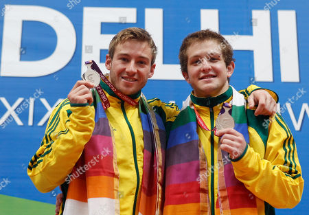 Matthew Mitcham, Ethan Warren Australia's Ethan Warren, left and Matthew Mitcham show their silver medals for the men's 10m synchro platform diving event during the Commonwealth Games at the Dr. S.P. Mukherjee Aquatics Center in New Delhi, India