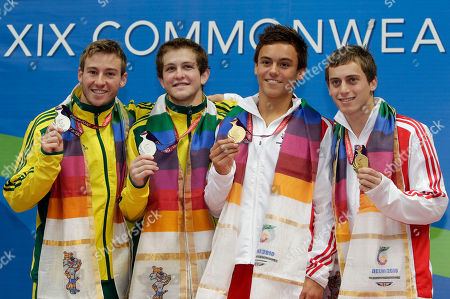 Matthew Mitcham, Ethan Warren, Tom Daley, Max Brick From left, Australia's Matthew Mitcham and Ethan Warren, silver, and England's Tom Daley and Max Brick, gold show their medals for the men's 10m synchro platform diving event during the Commonwealth Games at the Dr. S.P. Mukherjee Aquatics Center in New Delhi, India
