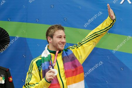 Matthew Mitcham Australia's Matthew Mitcham celebrates with his silver medal in the men's 10m platform diving event during the Commonwealth Games at the Dr. S.P. Mukherjee Aquatics Center in New Delhi, India