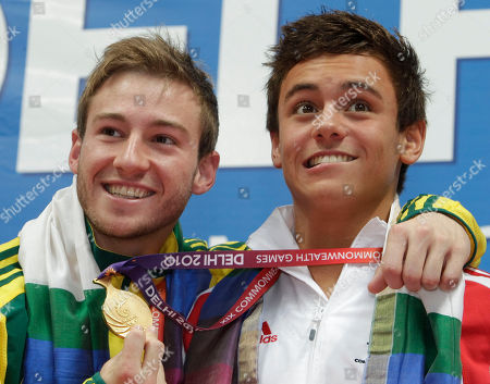 Tom Daley, Matthew Mitcham Silver medal winner Australia's Matthew Mitcham, left, steals in a joke the gold medal of England's Tom Daley, right, as they pose on the podium of the men's 10m platform diving event during the Commonwealth Games at the Dr. S.P. Mukherjee Aquatics Center in New Delhi, India