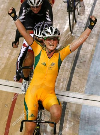 Megan Dunn Australia's Megan Dunn celebrates as she wins the gold medal in the women's 25 km points race at the Commonwealth Games in New Delhi, India