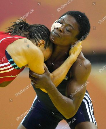 Lovina Odohi Edward, Non Evans Nigeria's Lovina Odohi Edward, right, wrestles with Wales' Non Evans for the bronze medal in the women's 55kg free style wrestling bout during the Commonwealth Games at the Indira Gandhi Sports Complex in New Delhi, India