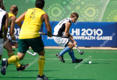Steve Edwards New Zealand's Steve Edwards, right, controls the ball in the men's semifinal field hockey match against Australia during the Commonwealth Games at the Major Dhyan Chand National Stadium in New Delhi, India