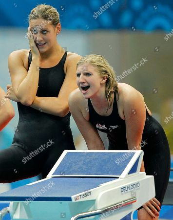 England's Rebecca Adlington, right, shouts as teammate Joanne Jackson watches during the 4x200 freestyle relay final in the Commonwealth Games at the Dr. S.P. Mukherjee Aquatics Center in New Delhi, India, . England won the bronze medal