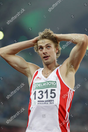 England's Christopher Tomlinson reacts after taking a jump in the Men's Long Jump final during the Commonwealth Games at the Jawaharlal Nehru Stadium in New Delhi, India