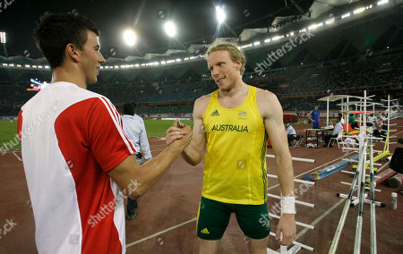 Australia's Steve Hooker, right, shakes hands with England's Steven Lewis, left, following the Men's Pole Vault final during the Commonwealth Games at the Jawaharlal Nehru Stadium in New Delhi, India
