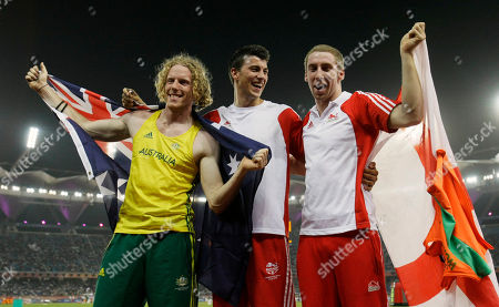 From left, Australia's Steve Hooker, England's Steven Lewis, and England's Max Eaves pose for photographers following the Men's Pole Vault final during the Commonwealth Games at the Jawaharlal Nehru Stadium in New Delhi, India