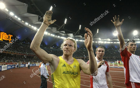 Australia's Steve Hooker, left, England's Max Eaves, center, and England's Steven Lewis, right, gesture to the crowd following the Men's Pole Vault final during the Commonwealth Games at the Jawaharlal Nehru Stadium in New Delhi, India