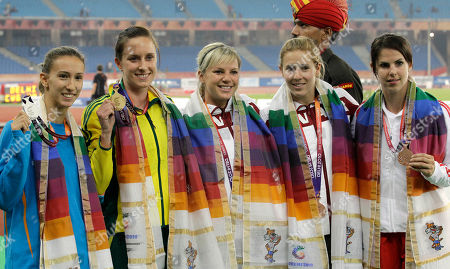 From left, Cyprus' Marianna Zachariadi, Australia's Alana Boyd, Canada's Carly Dockendorf, Canada's Kelsie Hendry, and England's Kate Dennison pose with their medals for the Women's Pole Vault during the Commonwealth Games at the Jawaharlal Nehru Stadium in New Delhi, India, . Boyd won gold, Zachariadi silver, Hendry, Dennison, and Dockendorf bronze
