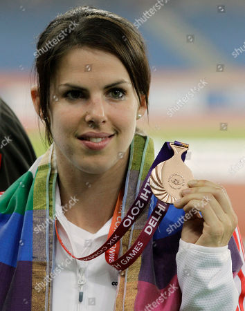 England's Kate Dennison poses with her bronze medal for the Women's Pole Vault final during the Commonwealth Games at the Jawaharlal Nehru Stadium in New Delhi, India