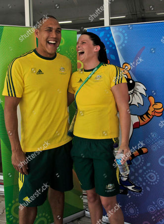 Australian swimmers Leisel Jones, right, and Geoff Huegill, left, pose for photographers following a press conference at the Commonwealth Games athletes' village, in New Delhi, India, . The Commonwealth Games are scheduled to begin Sunday