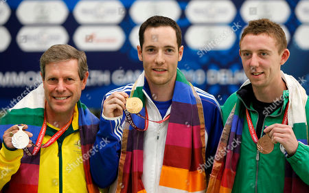 Jonathan Hammond, Matthew Hall, Warren Potent Scotland's Gold medalist Jonathan Hammond, center, Northern Ireland's bronze medalist Matthew Hall, right, and Australia's silver medalist Warren Potent, left, pose with their medals after the men's singles 50m rifle prone at the Commonwealth Games in New Delhi, India