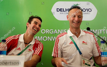 Stock Photo of England chef de mission Craig Hunter, right, and athlete Nathan Robertson, left, react at the end of a press conference at the Commonwealth Games athletes' village in New Delhi, India, . The Commonwealth Games are scheduled to begin on Sunday