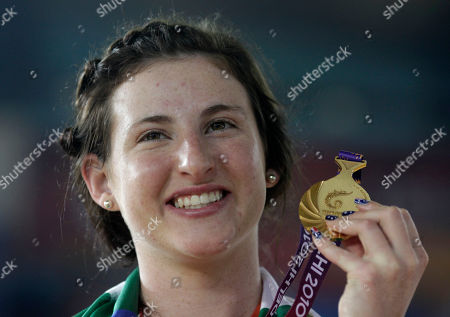 Megan Dunn Australian cyclist Megan Dunn beams with the gold medal she won in the women's 10km scratch final during the Commonwealth Games in New Delhi, India