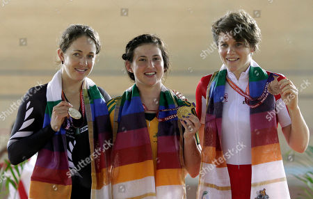 Joanne Kiesanowski, Megan Dunn, Anna Blyth From left to right, Cyclists Joanne Kiesanowski of New Zealand, Megan Dunn of Australia and Anna Blyth of England display their silver, gold and bronze medals respectively for the Women's Scratch 10km during the Commonwealth Games in New Delhi, India