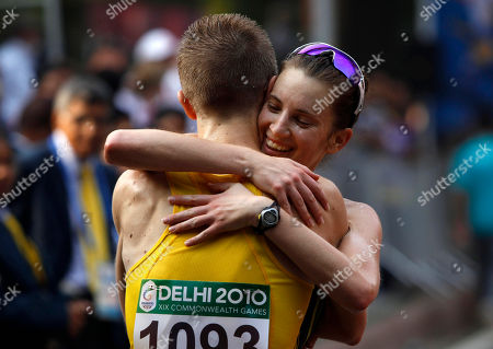 Jared Tallent, Claire Tallent Australia's Jared Tallent is hugged by his wife Claire Tallent after winning the gold medal in the men's 20km walk during the Commonwealth Games in New Delhi, India, . Clair Tllent won silver in the women's 20km walk